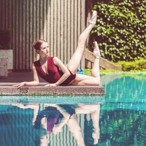 Reflection of ballet dancer by pool