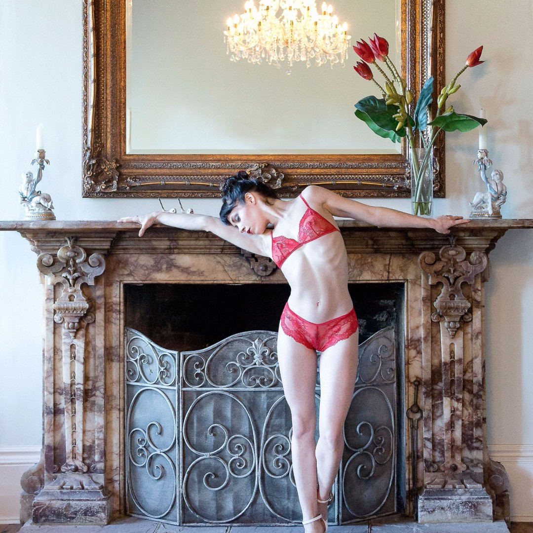 Beautiful setting featuring a gorgeous model and delicate red lace lingerie.