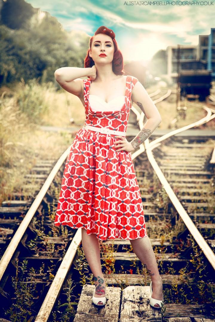 Promotional shot for Bernie Dexter Nauticle Orange Rope dress Ft Pin up model Jessica Hollie
